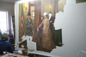 David Koch works on the Seraph Young mural