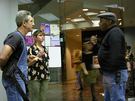Ed Hymas & wife Diana Lea--ceramists, talking to John Little--metalworker